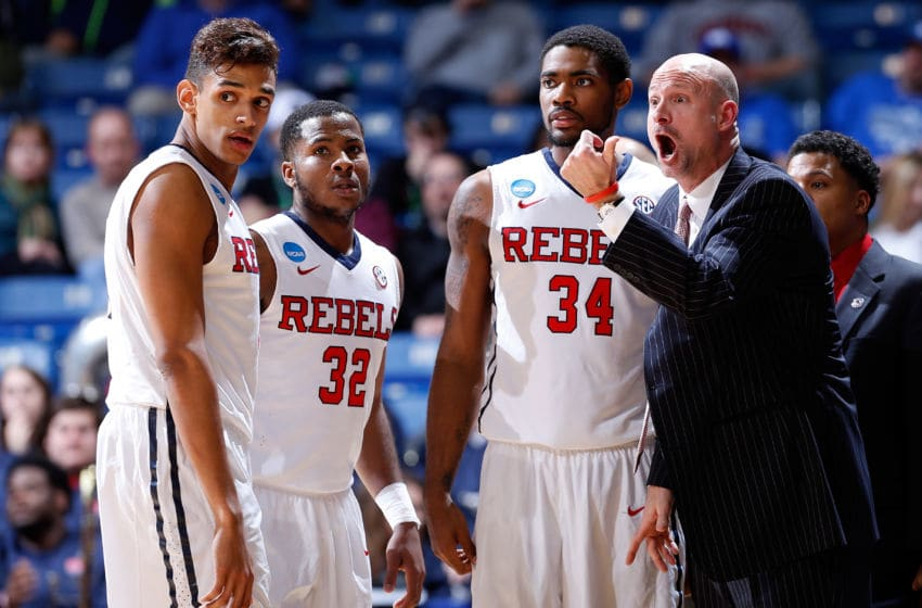 DAYTON, OH - MARCH 17: SEC basketball Head coach Andy Kennedy of the Mississippi Rebels speaks with his players . (Photo by Joe Robbins/Getty Images)