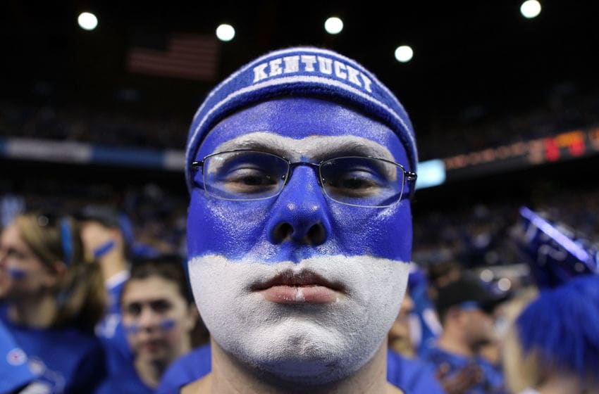 LEXINGTON, KY - DECEMBER 31: A Kentucky basketball fan cheers for the Kentucky Wildcats during the game against the Louisville Cardinals at Rupp Arena on December 31, 2011 in Lexington, Kentucky. (Photo by Andy Lyons/Getty Images)