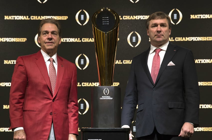University of Alabama head coach Nick Saban (left) and University of Georgia football head coach Kirby Smart stand (Photo by Mike Zarrilli/Getty Images)
