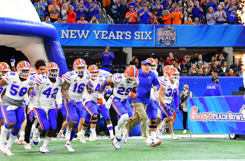 ATLANTA, GEORGIA - DECEMBER 29: Head coach Dan Mullen of the Florida Gators leads his team out of the tunnel prior to the Chick-fil-A Peach Bowl against the Michigan Wolverines at Mercedes-Benz Stadium on December 29, 2018 in Atlanta, Georgia. (Photo by Scott Cunningham/Getty Images)