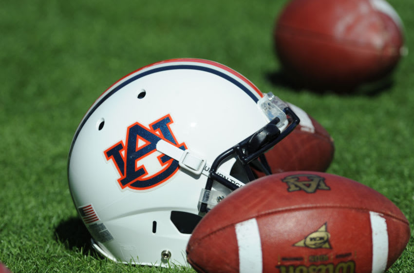 A helmet and footballs of the Auburn Tigers (Photo by Al Messerschmidt/Getty Images)