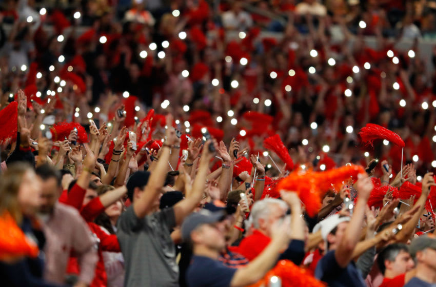 Fans turn on their phone flashlights to signal the start of the fourth quarter during the SEC Championship (Photo by Kevin C. Cox/Getty Images)