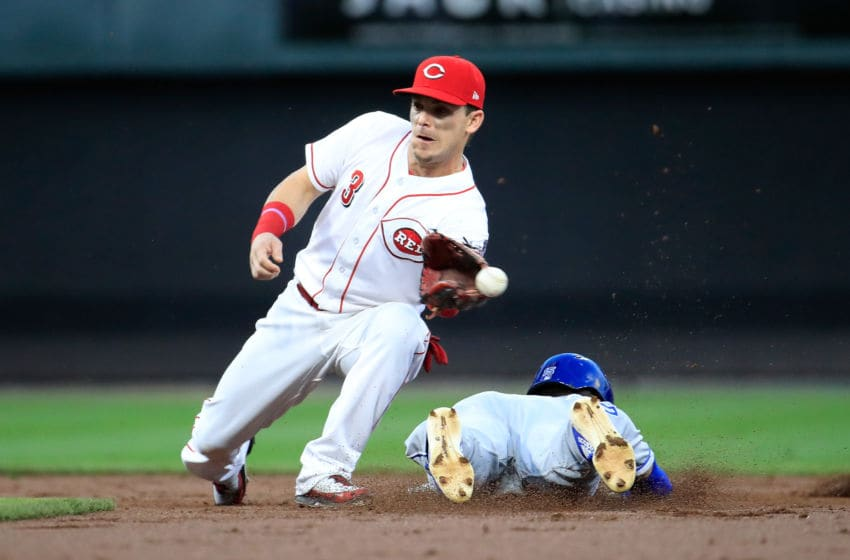 CINCINNATI, OH - SEPTEMBER 26: Scooter Gennett #3 of the Cincinnati Reds cant control the ball as Whit Merrifield #15 Kansas City Royals slides safely into second base for a stolen base at Great American Ball Park on September 26, 2018 in Cincinnati, Ohio. (Photo by Andy Lyons/Getty Images)