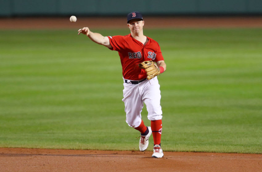 BOSTON, MASSACHUSETTS - SEPTEMBER 09: Brock Holt #12 of the Boston Red Sox throws to first base during the second inning of the game between the Boston Red Sox and the New York Yankees at Fenway Park on September 09, 2019 in Boston, Massachusetts. (Photo by Maddie Meyer/Getty Images)