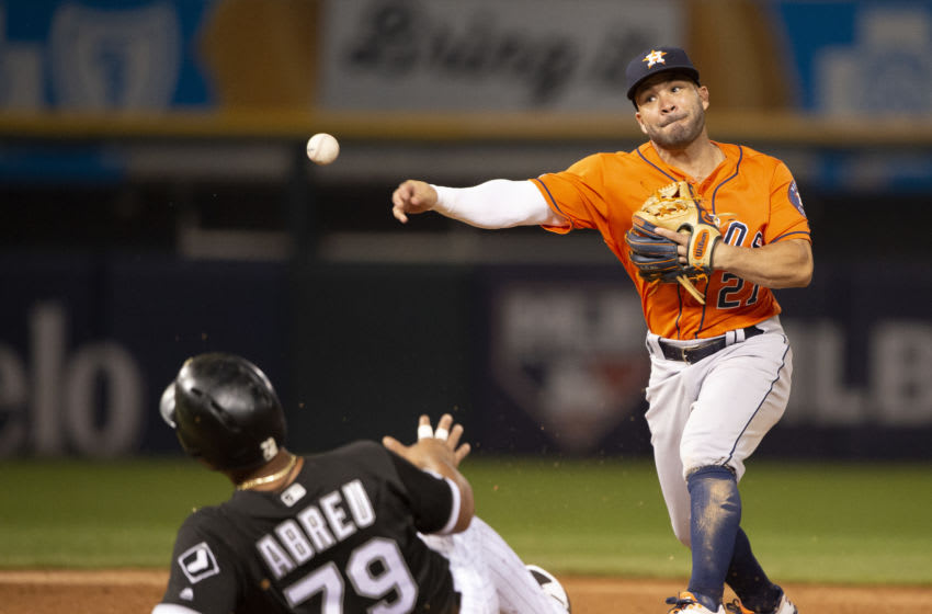 CHICAGO - AUGUST 13: Jose Altuve #27 of the Houston Astros turns a double play during the second game of a double header against the Chicago White Sox on August 13, 2019 at Guaranteed Rate Field in Chicago, Illinois. (Photo by Ron Vesely/MLB Photos via Getty Images)