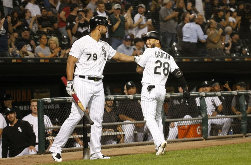 CHICAGO, ILLINOIS - SEPTEMBER 25: Leury Garcia #28 of the Chicago White Sox is congratulated by Jose Abreu #79 after he scored during the first inning of a game at Guaranteed Rate Field on September 25, 2019 in Chicago, Illinois. (Photo by Nuccio DiNuzzo/Getty Images)