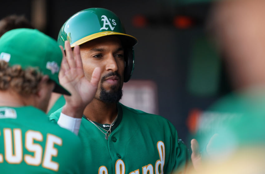 OAKLAND, CALIFORNIA - OCTOBER 02: Marcus Semien #10 of the Oakland Athletics celebrates scoring on a sacrifice fly by Ramon Laureano #22 in the third inning of the American League Wild Card Game against the Tampa Bay Rays at RingCentral Coliseum on October 02, 2019 in Oakland, California. (Photo by Thearon W. Henderson/Getty Images)
