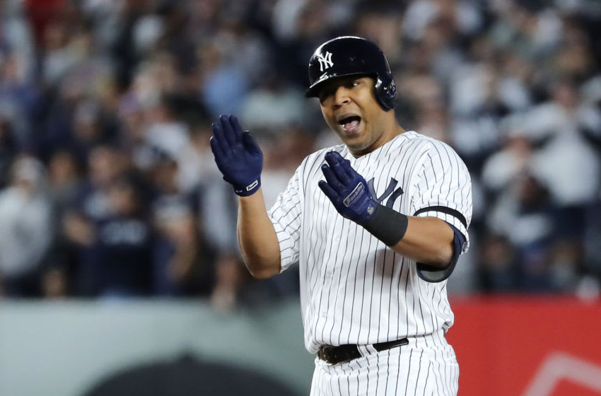 NEW YORK, NEW YORK - OCTOBER 15: Edwin Encarnacion #30 of the New York Yankees celebrates hitting a double during the fifth inning against the Houston Astros in game three of the American League Championship Series at Yankee Stadium on October 15, 2019 in New York City. (Photo by Elsa/Getty Images)