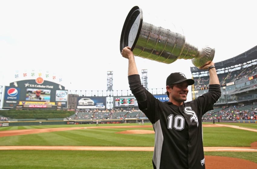 CHICAGO, IL - JULY 03: Patrick Sharp #10 of the Chicago Blackhawks holds up the Stanley Cup Trophy before the Chicago White Sox take on the Baltimore Orioles at U.S. Cellular Field on July 3, 2013 in Chicago, Illinois. (Photo by Jonathan Daniel/Getty Images)
