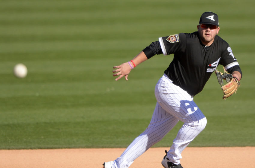 GLENDALE, ARIZONA - FEBRUARY 25: Jake Burger #91 of the Chicago White Sox fields against the Cincinnati Reds on February 25, 2018 at Camelback Ranch in Glendale Arizona. (Photo by Ron Vesely/MLB Photos via Getty Images)