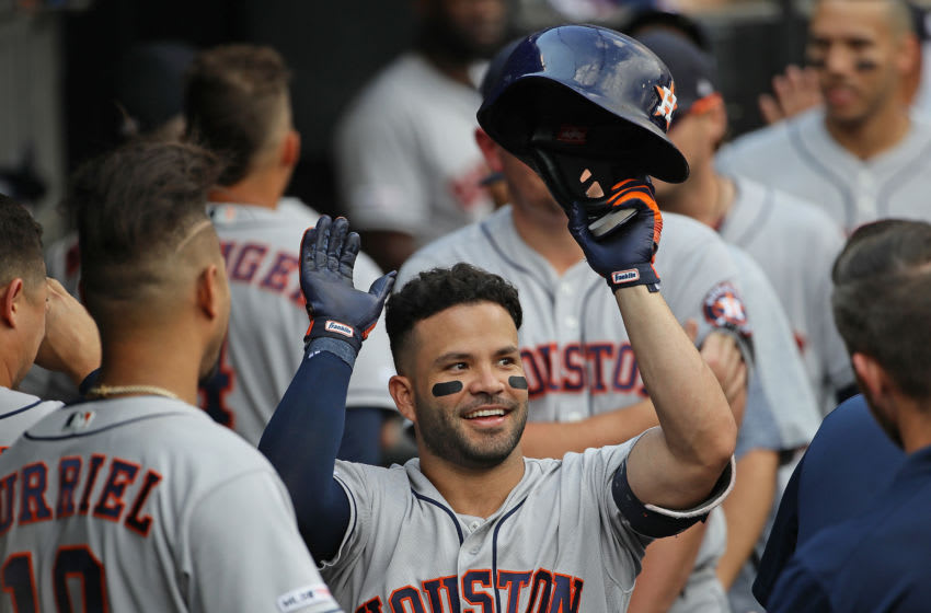 CHICAGO, ILLINOIS - AUGUST 14: Jose Altuve #27 of the Houston Astros is greeted in the dugout after hitting the game-tying, two run home run in the 8th inning against the Chicago White Sox at Guaranteed Rate Field on August 14, 2019 in Chicago, Illinois. (Photo by Jonathan Daniel/Getty Images)