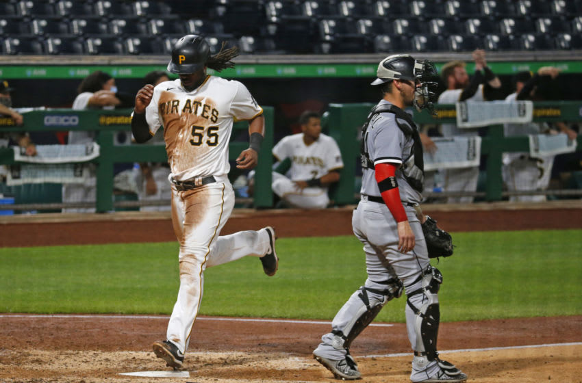 PITTSBURGH, PA - SEPTEMBER 08: Josh Bell #55 of the Pittsburgh Pirates scores on a triple in the fifth inning against the Chicago White Sox at PNC Park on September 8, 2020 in Pittsburgh, Pennsylvania. (Photo by Justin K. Aller/Getty Images)