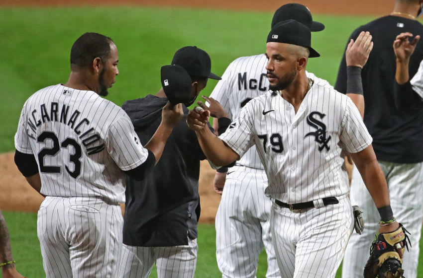 CHICAGO, ILLINOIS - SEPTEMBER 12: Edwin Encarnacion #23 (L) and Jose Abreu #79 of the Chicago White Sox celebrate a win over the Detroit Tigers at Guaranteed Rate Field on September 12, 2020 in Chicago, Illinois. The White Sox defeated the Tigers 14-0. (Photo by Jonathan Daniel/Getty Images)