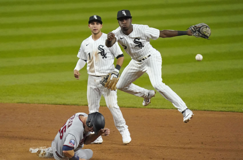 CHICAGO, ILLINOIS - SEPTEMBER 14: Tim Anderson #7 of the Chicago White Sox throws to first base while Max Kepler #26 of the Minnesota Twins is out at second base on a double play during the fifth inning of a game at Guaranteed Rate Field on September 14, 2020 in Chicago, Illinois. (Photo by Nuccio DiNuzzo/Getty Images)