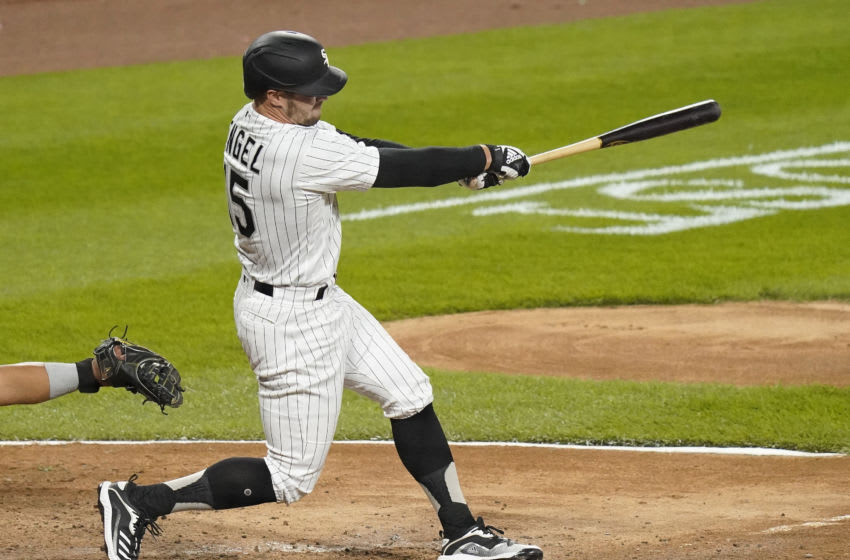 CHICAGO, ILLINOIS - SEPTEMBER 14: Adam Engel #15 of the Chicago White Sox hits an RBI single during the eighth inning of a game against the Minnesota Twins at Guaranteed Rate Field on September 14, 2020 in Chicago, Illinois. (Photo by Nuccio DiNuzzo/Getty Images)