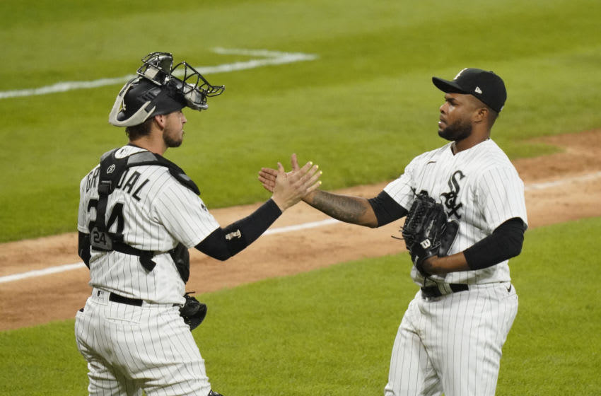 CHICAGO, ILLINOIS - SEPTEMBER 14: Yasmani Grandal #24 and Alex Colome #48 of the Chicago White Sox celebrate their team's 3-1 win over the Minnesota Twins at Guaranteed Rate Field on September 14, 2020 in Chicago, Illinois. (Photo by Nuccio DiNuzzo/Getty Images)