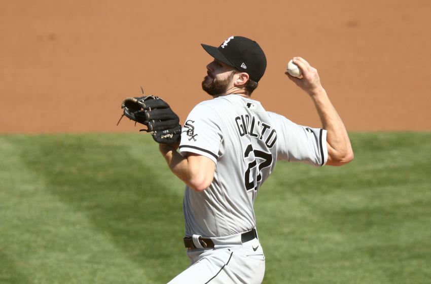 OAKLAND, CALIFORNIA - SEPTEMBER 29: Lucas Giolito #27 of the Chicago White Sox pitches against the Oakland Athletics in the first inning of game one of their wild card series at RingCentral Coliseum on September 29, 2020 in Oakland, California. (Photo by Ezra Shaw/Getty Images)