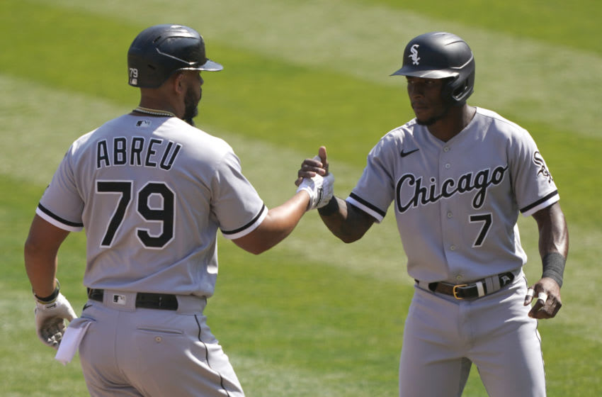 OAKLAND, CALIFORNIA - SEPTEMBER 29: Jose Abreu #79 of the Chicago White Sox is congratulated by Tim Anderson #7 after Abreu hit a two-run home run against the Oakland Athletics during the third inning of the Wild Card Round Game One at RingCentral Coliseum on September 29, 2020 in Oakland, California. (Photo by Thearon W. Henderson/Getty Images)