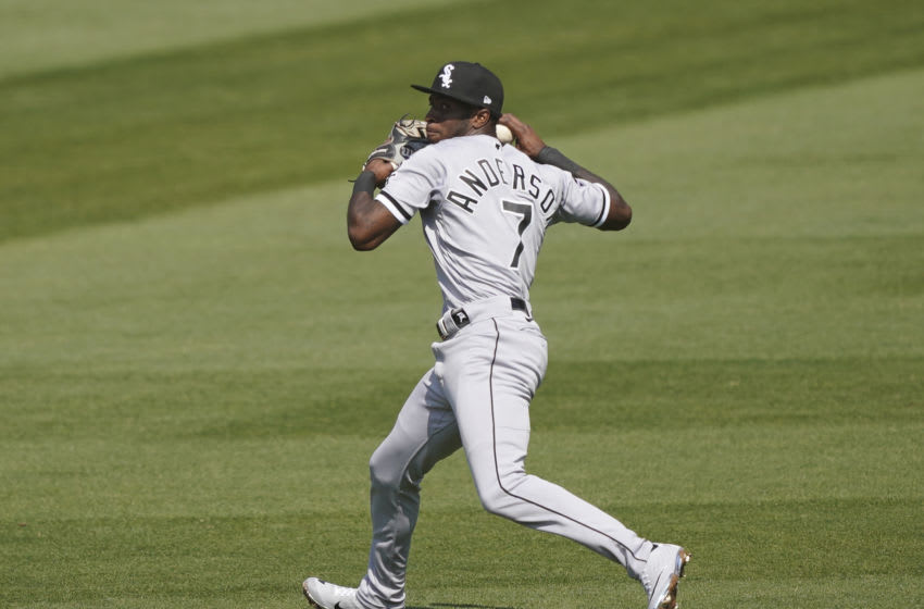 OAKLAND, CALIFORNIA - SEPTEMBER 30: Tim Anderson #7 of the Chicago White Sox throws off balance to first base but not in time to get Chad Pinder #18 of the Oakland Athletics during the first inning of Game Two of the American League Wild Card Round at RingCentral Coliseum on September 30, 2020 in Oakland, California. (Photo by Thearon W. Henderson/Getty Images)