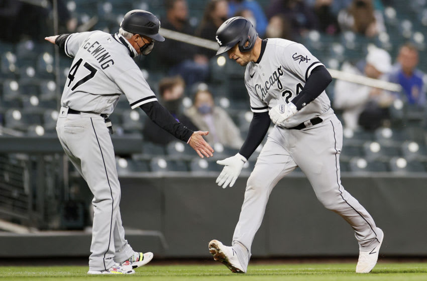 SEATTLE, WASHINGTON - APRIL 05: Yasmani Grandal #24 of the Chicago White Sox reacts after his home run against the Seattle Mariners in the second inning at T-Mobile Park on April 05, 2021 in Seattle, Washington. (Photo by Steph Chambers/Getty Images)