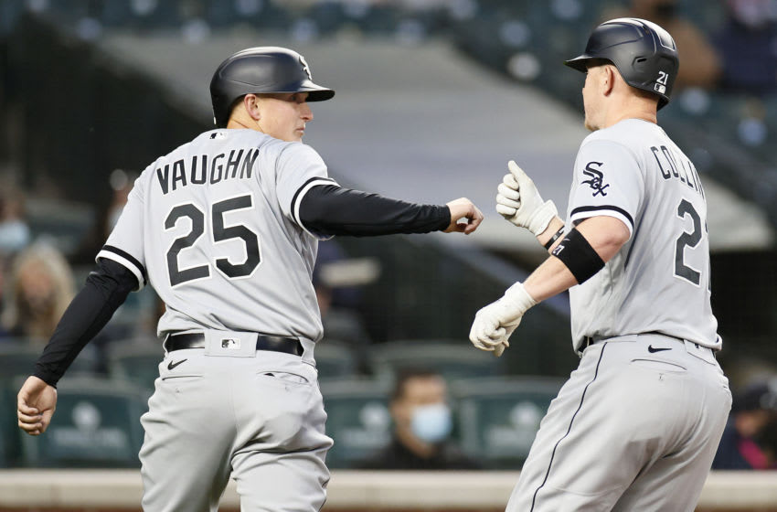 SEATTLE, WASHINGTON - APRIL 06: Andrew Vaughn #25 of the Chicago White Sox fist bumps Zack Collins #21 after Collins's three-run home run against the Seattle Mariners in the second inning at T-Mobile Park on April 06, 2021 in Seattle, Washington. (Photo by Steph Chambers/Getty Images)