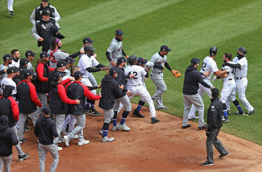 CHICAGO, ILLINOIS - APRIL 15: Benches and bullpens for the Chicago White Sox and the Cleveland Indians converge at second base during a 1st inning arguement at Guaranteed Rate Field on April 15, 2021 in Chicago, Illinois. All players are wearing the number 42 in honor of Jackie Robinson Day. (Photo by Jonathan Daniel/Getty Images)