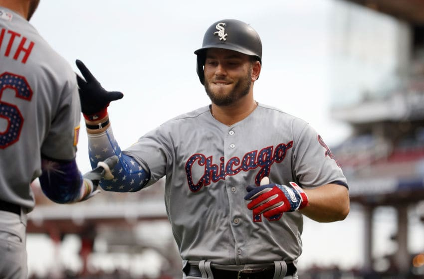 CINCINNATI, OH - JULY 04: Daniel Palka #18 of the Chicago White Sox is congratulated by Kevin Smith after hitting a home run in the fourth inning against the Cincinnati Reds at Great American Ball Park on July 4, 2018 in Cincinnati, Ohio. (Photo by Andy Lyons/Getty Images)