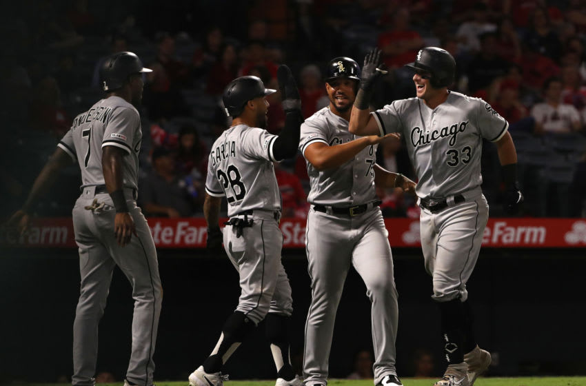 ANAHEIM, CALIFORNIA - AUGUST 16: James McCann #33 of the Chicago White Sox celebrates with teammates Tim Anderson #7, Leury Garcia #28 and Jose Abreu #79 after McCann hit a grand slam home run during the eighth inning of the MLB game against the Los Angeles Angels at Angel Stadium of Anaheim on August 16, 2019 in Anaheim, California. (Photo by Victor Decolongon/Getty Images)