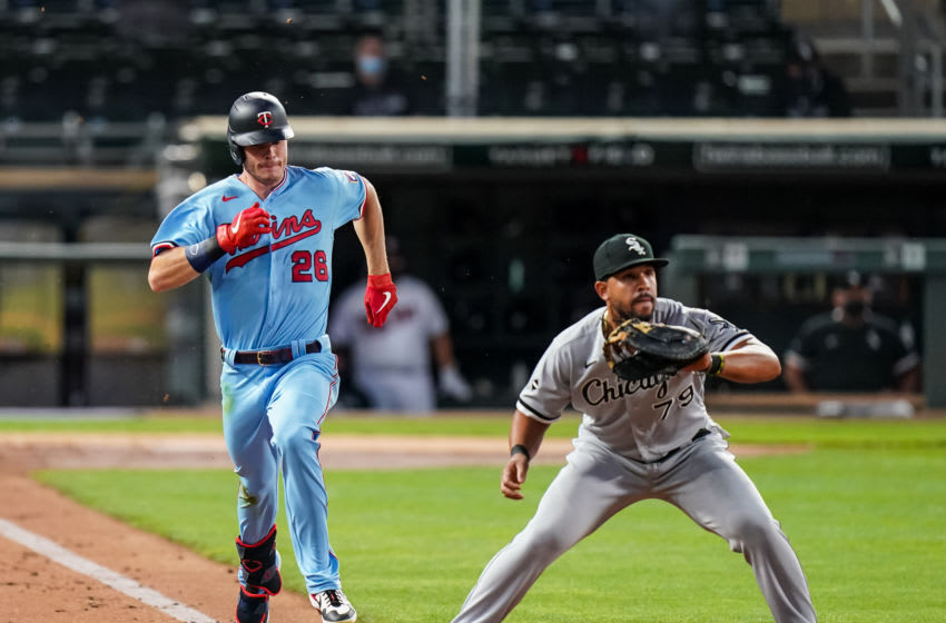 MINNEAPOLIS, MN - SEPTEMBER 02: Max Kepler #26 of the Minnesota Twins runs past Jose Abreu #79 of the Chicago White Sox on September 2, 2020 at Target Field in Minneapolis, Minnesota. (Photo by Brace Hemmelgarn/Minnesota Twins/Getty Images)