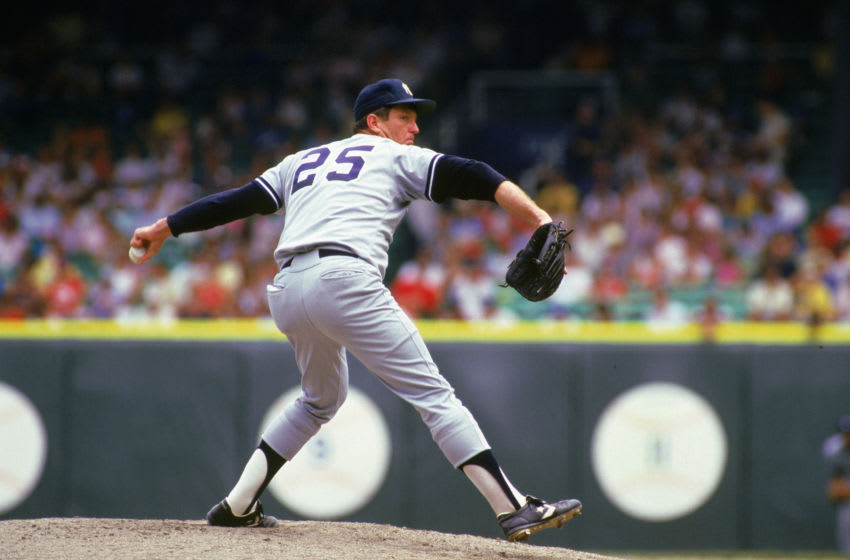 CHICAGO - 1987: Tommy John #25 of the New York Yankees pitches during a 1987 season game against the White Sox at Comiskey Park in Chicago Illinois. (Photo by Jonathan Daniel/Getty Images)
