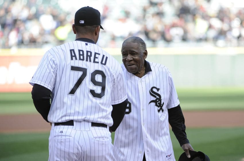 CHICAGO, IL - APRIL 26: Former Chicago White Sox player Minnie Minoso throws out the first pitch to Jose Abreu #79 of the Chicago White Sox before the game between the Chicago White Sox and the Tampa Bay Rays on April 26, 2014 at U.S. Cellular Field in Chicago, Illinois. (Photo by David Banks/Getty Images)