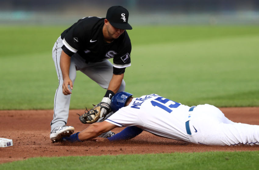 KANSAS CITY, MISSOURI - AUGUST 01: Whit Merrifield #15 of the Kansas City Royals is tagged out by Nick Madrigal #1 of the Chicago White Sox while attempting to steal during the 1st inning of the game at Kauffman Stadium on August 01, 2020 in Kansas City, Missouri. (Photo by Jamie Squire/Getty Images)