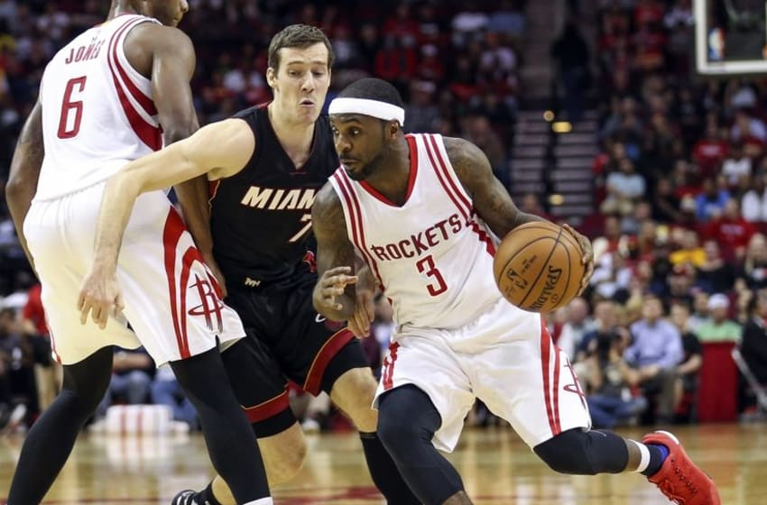 Feb 2, 2016; Houston, TX, USA; Houston Rockets guard Ty Lawson (3) dribbles the ball as Miami Heat guard Goran Dragic (7) defends during the second quarter at Toyota Center. Mandatory Credit: Troy Taormina-USA TODAY Sports