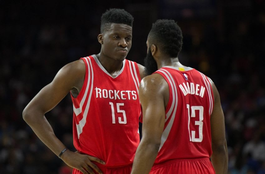 Mar 9, 2016; Philadelphia, PA, USA; Houston Rockets guard James Harden (13) and forward Clint Capela (15) talk during a break in the second half against the Philadelphia 76ers at Wells Fargo Center. The Houston Rockets won 118-104. Mandatory Credit: Bill Streicher-USA TODAY Sports