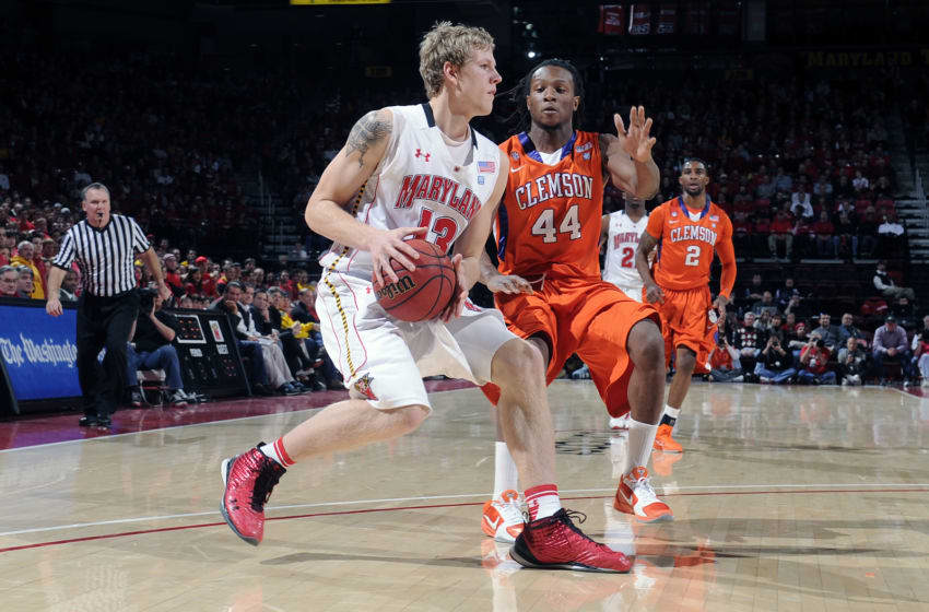 COLLEGE PARK, MD - JANUARY 22: Haukur Palsson #13 of the Maryland Terrapins drives to the hoop against DeAndre Hopkins #44 of the Clemson Tigers at the Comcast Center on January 22, 2011 in College Park, Maryland. (Photo by G Fiume/Maryland Terrapins/Getty Images)