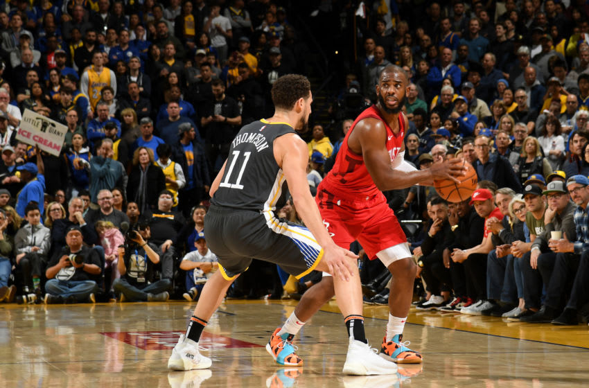 OAKLAND, CA - FEBRUARY 23: Chris Paul #3 of the Houston Rockets handles the ball against the Golden State Warriors on February 23, 2019 at ORACLE Arena in Oakland, California. NOTE TO USER: User expressly acknowledges and agrees that, by downloading and or using this photograph, User is consenting to the terms and conditions of the Getty Images License Agreement. Mandatory Copyright Notice: Copyright 2019 NBAE (Photo by Noah Graham/NBAE via Getty Images)