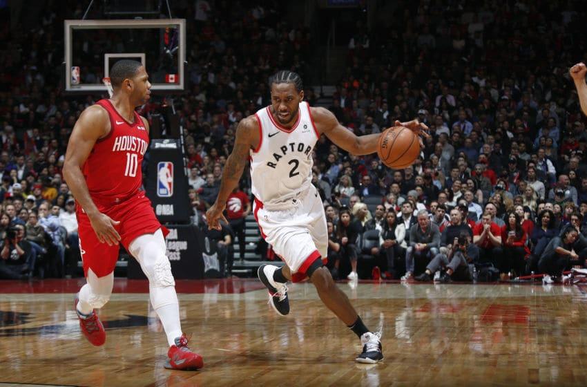 Kawhi Leonard #2 of the Toronto Raptors handles the ball against the Houston Rockets (Photo by Mark Blinch/NBAE via Getty Images)