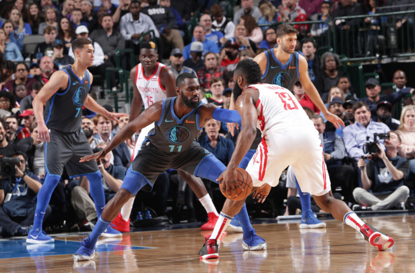 Tim Hardaway Jr. #11 of the Dallas Mavericks defends against James Harden #13 of the Houston Rockets (Photo by Glenn James/NBAE via Getty Images)