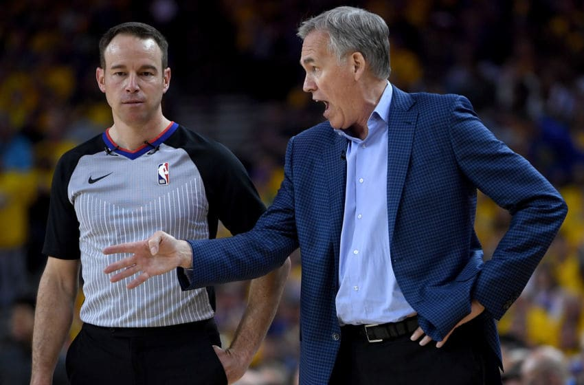 Head coach Mike D'Antoni of the Houston Rockets complains to referee Josh Tivens #58 (Photo by Thearon W. Henderson/Getty Images)
