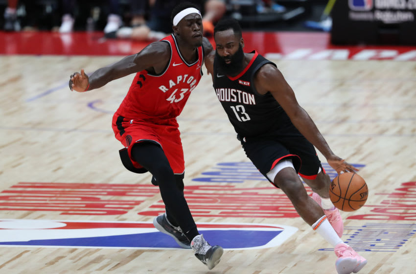 SAITAMA, JAPAN - OCTOBER 10: James Harden #13 of Houston Rockets drives to the basket against Pascal Siakam #43 of Toronto Raptors during the preseason match between Toronto Raptors and Houston Rockets at Saitama Super Arena on October 10, 2019 in Saitama, Japan. NOTE TO USER: User expressly acknowledges and agrees that, by downloading and/or using this photograph, user is consenting to the terms and conditions of the Getty Images License Agreement. (Photo by Takashi Aoyama/Getty Images)