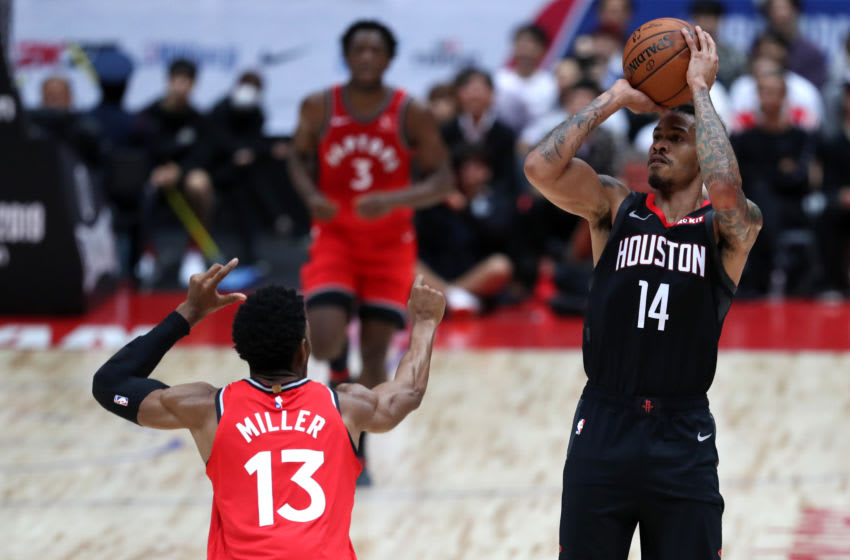 SAITAMA, JAPAN - OCTOBER 10: Gerald Green #14 of Houston Rockets shoots against Malcolm Miller #13 of Toronto Raptors during the preseason game between Toronto Raptors and Houston Rockets at Saitama Super Arena on October 10, 2019 in Saitama, Japan. NOTE TO USER: User expressly acknowledges and agrees that, by downloading and/or using this photograph, user is consenting to the terms and conditions of the Getty Images License Agreement. (Photo by Takashi Aoyama/Getty Images)