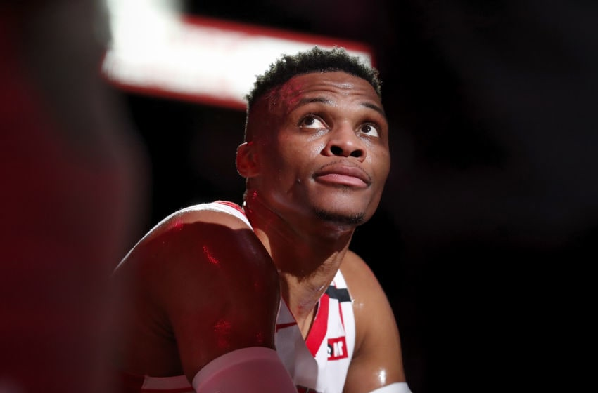 HOUSTON, TEXAS - MARCH 08: Russell Westbrook #0 of the Houston Rockets reacts on the bench in the first half against the Orlando Magic at Toyota Center on March 08, 2020 in Houston, Texas. NOTE TO USER: User expressly acknowledges and agrees that, by downloading and or using this photograph, User is consenting to the terms and conditions of the Getty Images License Agreement. (Photo by Tim Warner/Getty Images)