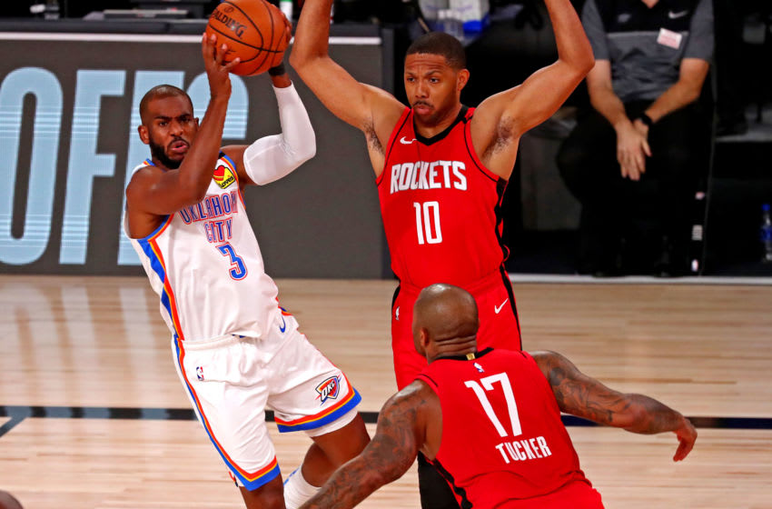 Chris Paul #3 of the Oklahoma City Thunder passes the ball against Eric Gordon#10 and P.J. Tucker #17 Houston Rockets (Photo by Kim Klement-Pool/Getty Images)