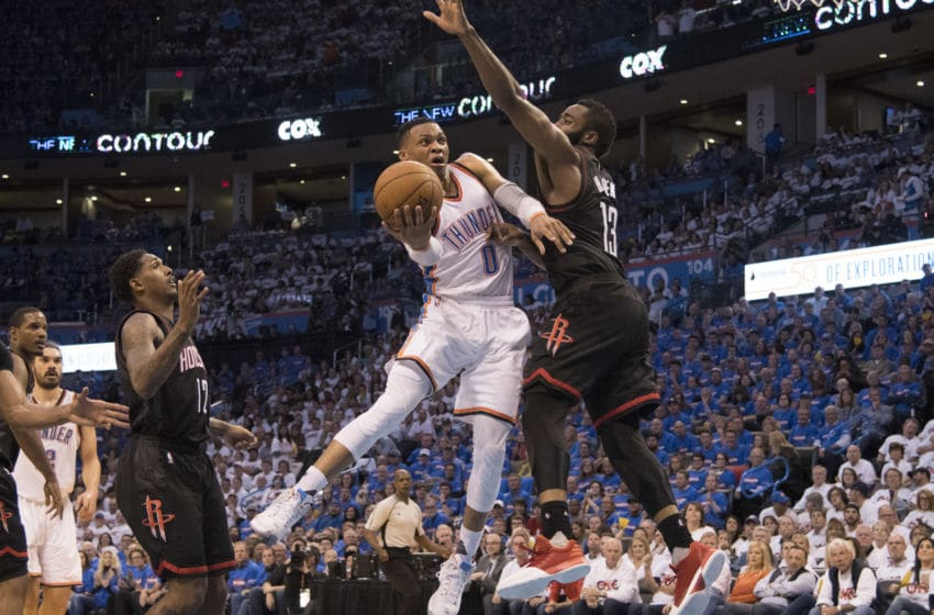 OKLAHOMA CITY, OK - APRIL 21: Russell Westbrook #0 of the Oklahoma City Thunder drives around James Harden #13 of the Houston Rockets for two points during the second half of Game Three in the 2017 NBA Playoffs Western Conference Quarterfinals on April 21, 2017 in Oklahoma City, Oklahoma. Oklahoma City defeated Houston 115-113 NOTE TO USER: User expressly acknowledges and agrees that, by downloading and or using this photograph, User is consenting to the terms and conditions of the Getty Images License Agreement. (Photo by J Pat Carter/Getty Images)