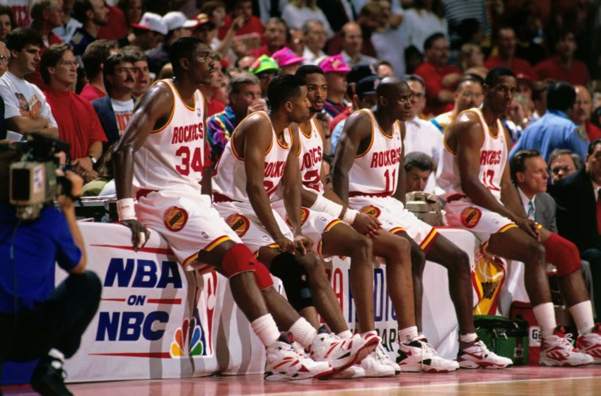 HOUSTON - JUNE 22: Hakeem Olajuwon #34, Kenny Smith #30, Robert Horry #25, Vernon Maxwell #11 and Otis Thorpe #33 of the Houston Rockets wait at the scorers table during Game Seven of the NBA Finals played on June 22, 1994 at The Summit in Houston, Texas. NOTE TO USER: User expressly acknowledges that, by downloading and or using this photograph, User is consenting to the terms and conditions of the Getty Images License agreement. Mandatory Copyright Notice: Copyright 1994 NBAE (Photo by Nathaniel S. Butler/NBAE via Getty Images)