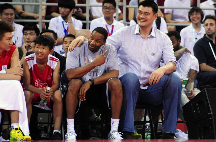 Tracy McGrady, Yao Ming, Houston Rockets (Photo credit should read STR/AFP via Getty Images)