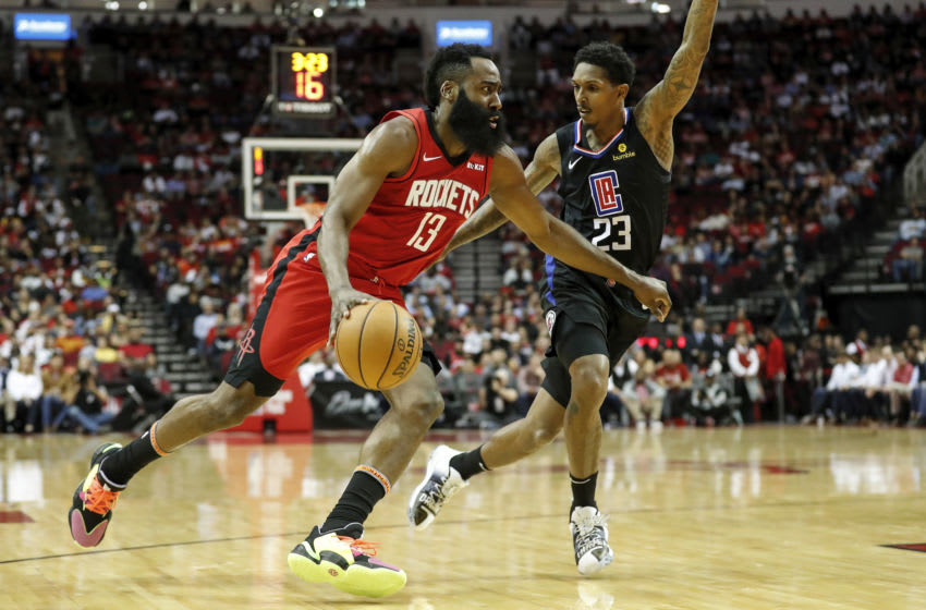 James Harden #13 of the Houston Rockets drives to the basket while defended by Lou Williams #23 of the LA Clippers (Photo by Tim Warner/Getty Images)