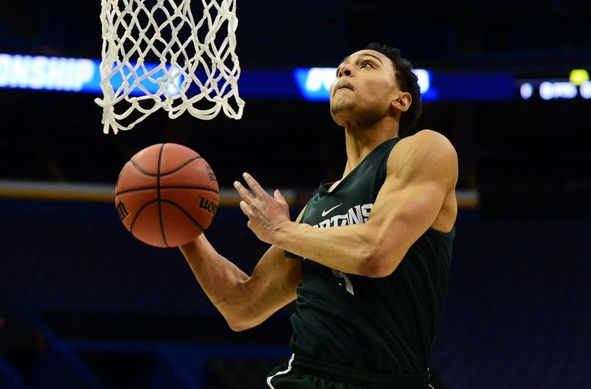 Mar 17, 2016; St. Louis, MO, USA; Michigan State Spartans guard Bryn Forbes (5) dunks during a practice day before the first round of the NCAA men