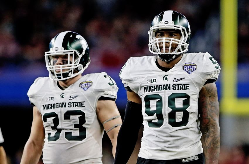 Dec 31, 2015; Arlington, TX, USA; Michigan State Spartans linebacker Jon Reschke (33) and defensive end Demetrius Cooper (98) in action during the game against the Alabama Crimson Tide in the 2015 CFP semifinal at the Cotton Bowl at AT&T Stadium. Mandatory Credit: Kevin Jairaj-USA TODAY Sports