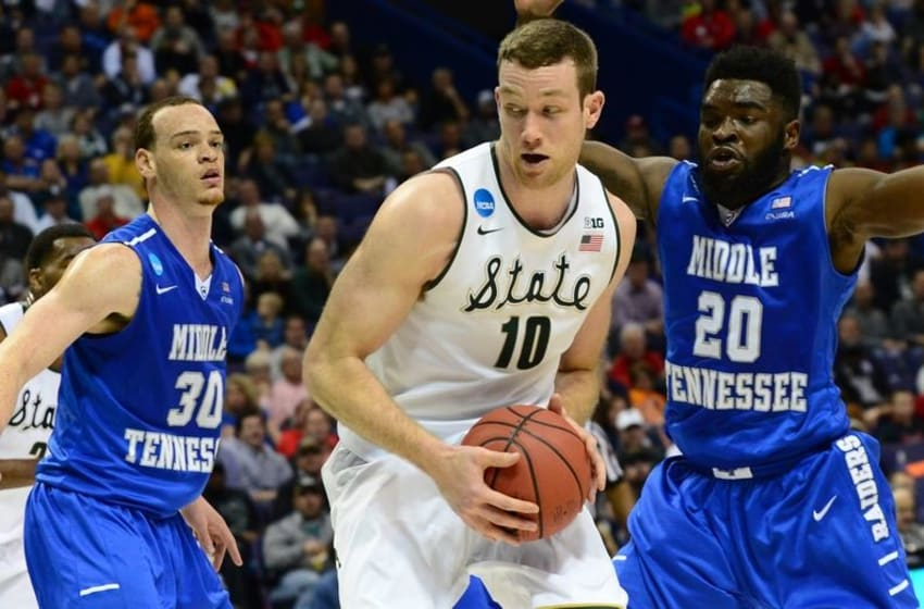 Mar 18, 2016; St. Louis, MO, USA; Michigan State Spartans forward Matt Costello (10) works around the defense of Middle Tennessee Blue Raiders forward Reggie Upshaw (30) and guard Giddy Potts (20) during the second half of the first round in the 2016 NCAA Tournament at Scottrade Center. Mandatory Credit: Jeff Curry-USA TODAY Sports